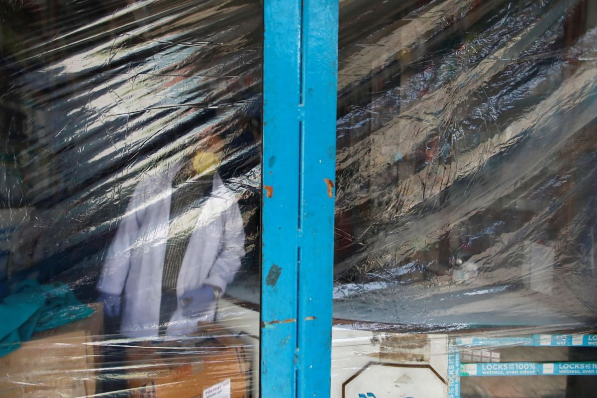 A drugstore is seen layered by a plastic sheet in Kathmandu, Nepal, on March 25, 2020.