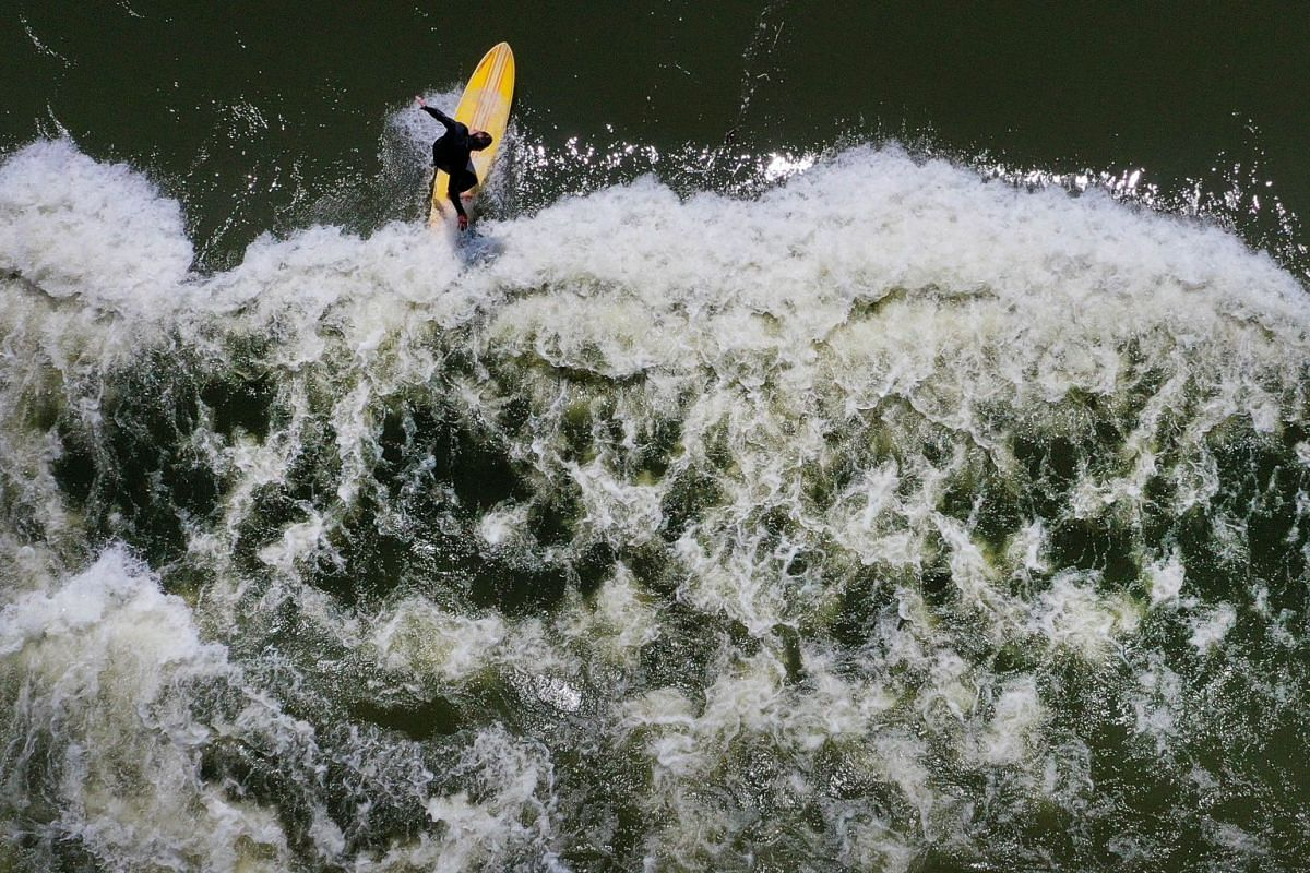 An aerial view from a drone as a surfer catches a standing wave on the Trinity River in Fort Worth, Texas, on March 21, 2020.