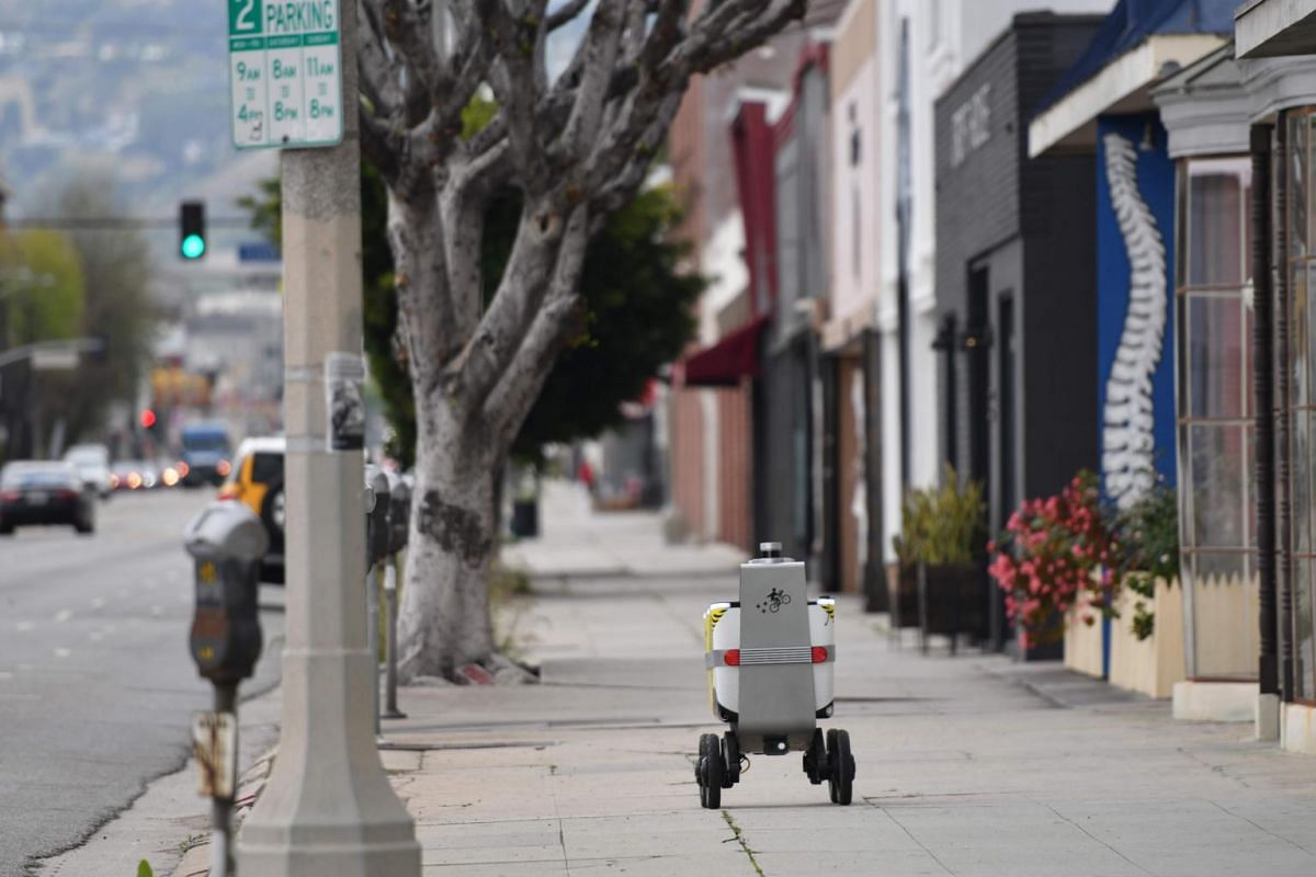 A Postmate delivery robot on its route to deliver food to customers in Los Angeles, on March 24, 2020.