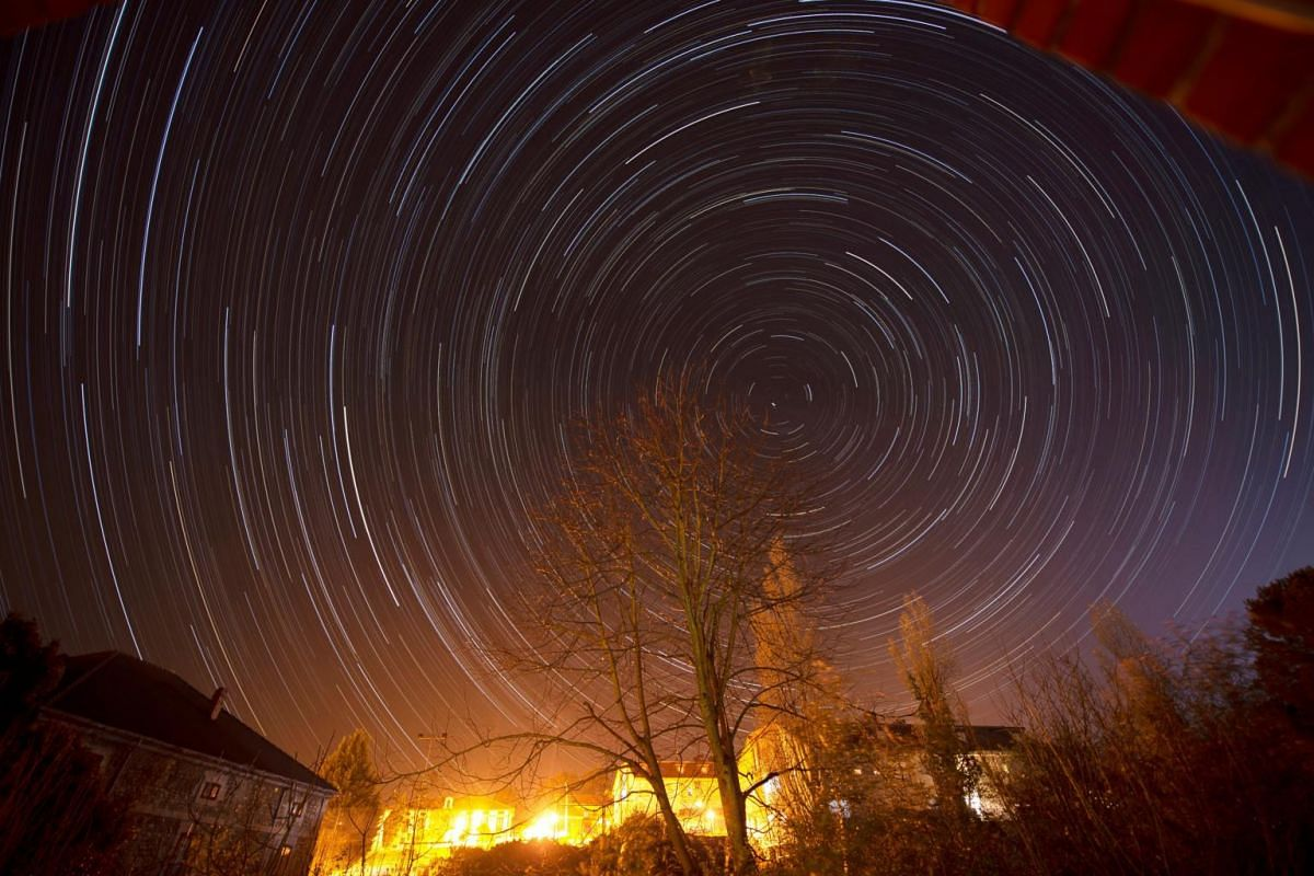 A photography taken with a slow shutter speed shows circumpolar stars from the village of Hinojedo, Spain, on March 25, 2020.