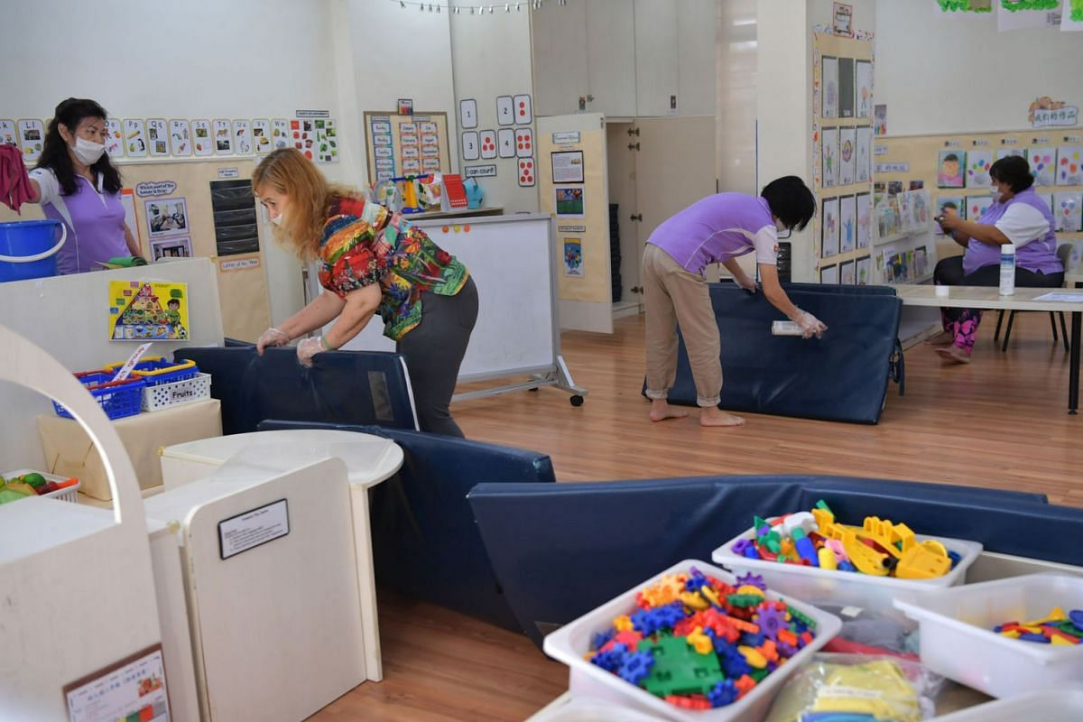 Staff cleaning the Nursery 2 classroom at a PAP Community Foundation Sparkletots pre-school at Block 305 Clementi Avenue 4 on March 26, 2020. All 360 centres under PAP Community Foundation (PCF) will close for four days from Thursday (March 26) after