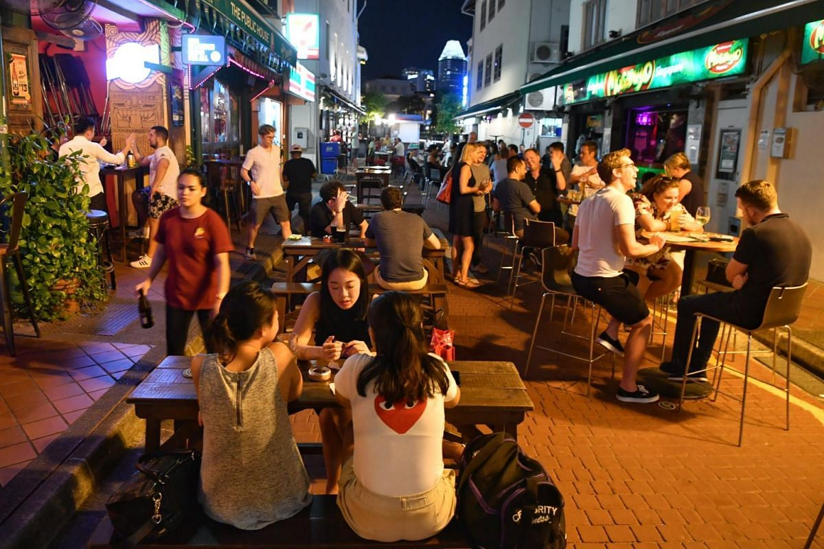 Patrons at pubs along Boat Quay at 10.10pm on March 26, 2020.