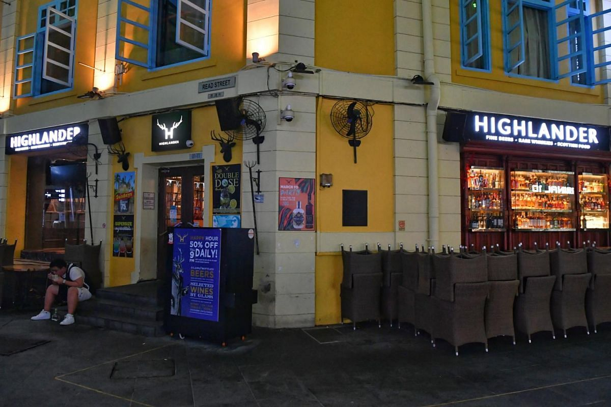Chairs neatly stacked up outside Highlander in Clark Quay at 12.30am on March 27, 2020.