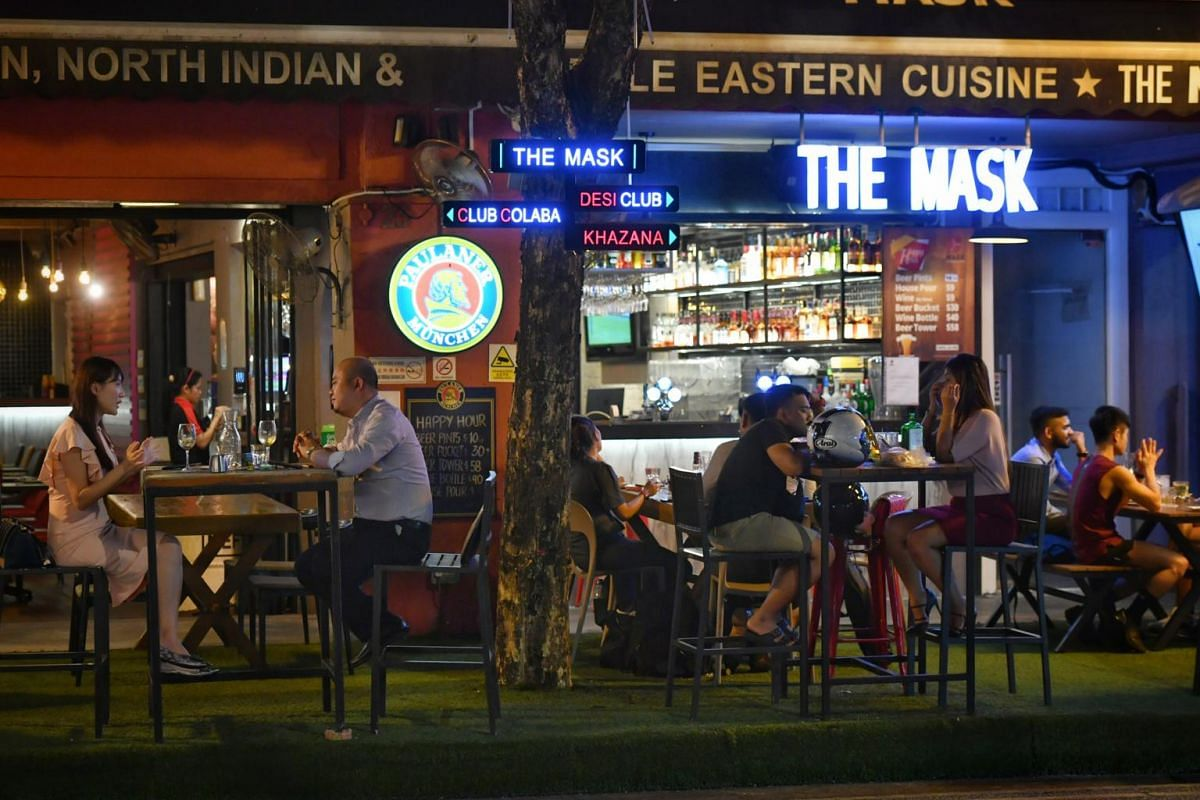 Patrons at pubs in Boat Quay at 10.30pm on March 26, 2020.