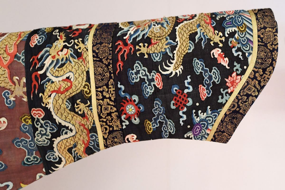 """Detail on the sleeve of a """"dragon robe"""", the classic embodiment of Qing court dress, on show at the Asian Civilisations Museum."""