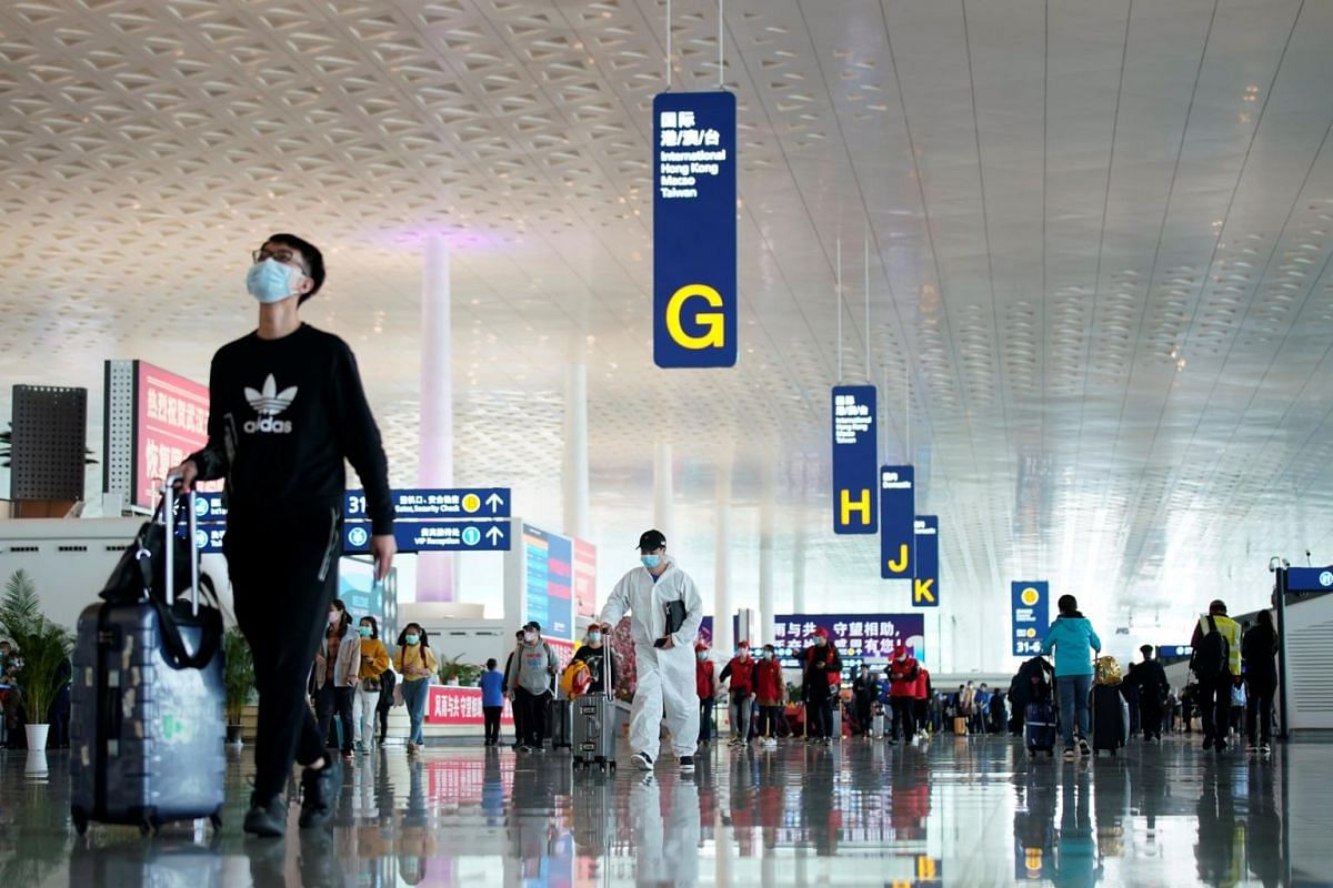 Travellers are seen at the Wuhan Tianhe International Airport after travel restrictions to leave Wuhan were lifted, on April 8, 2020.
