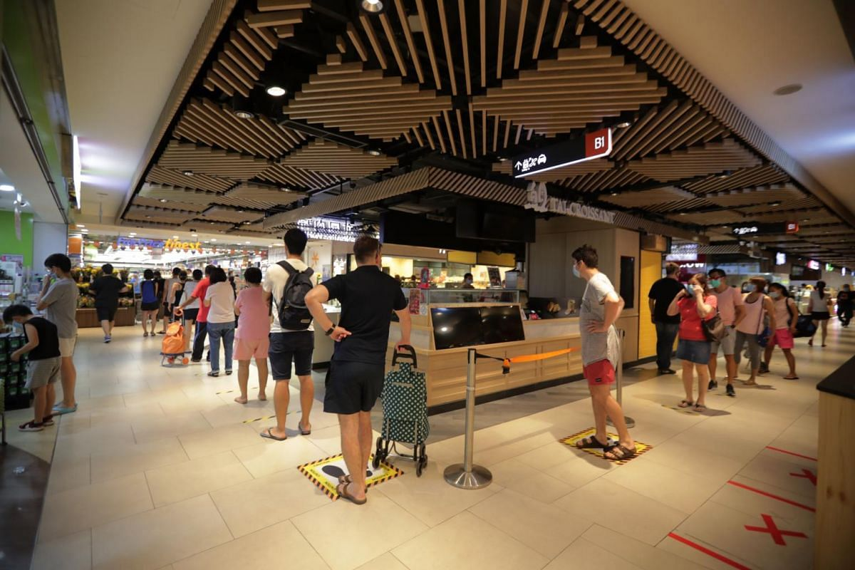 A queue forms outside FairPrice Finest at Clementi Mall on April 10, 2020.