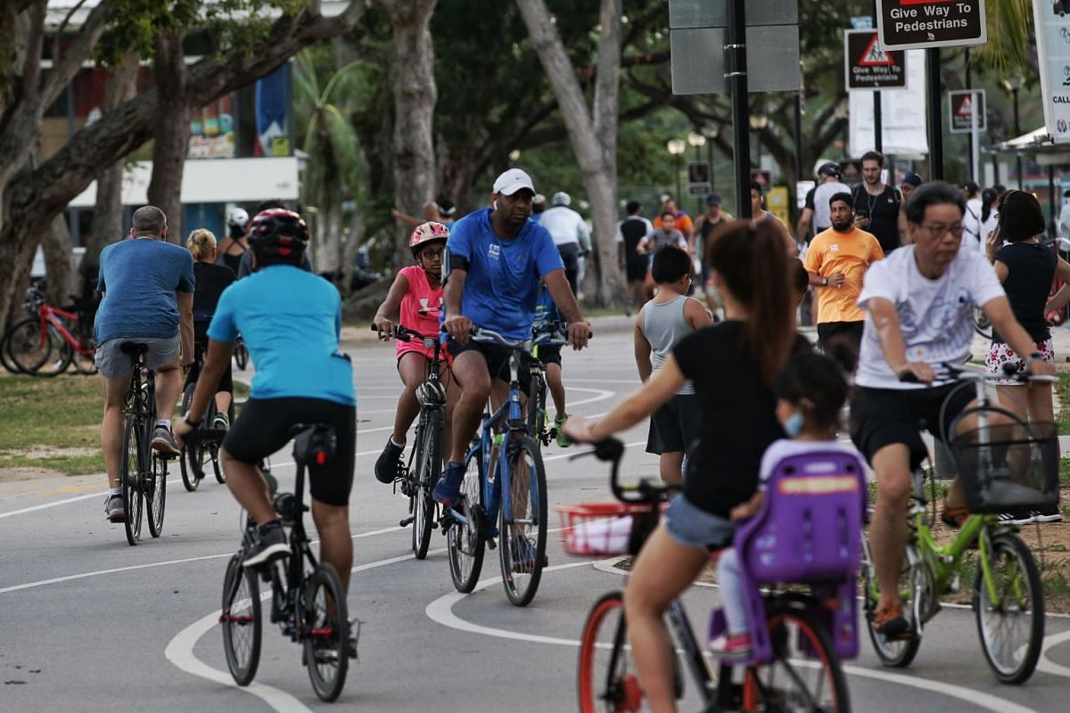 Heavy traffic of cyclists and joggers is seen at a bend next to East Coast Park Food Centre on April 11, 2020.