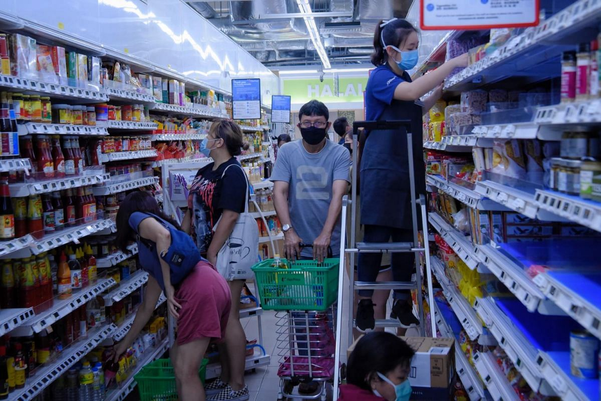 A majority of shoppers had masks on at FairPrice Hillion on April 11, 2020.