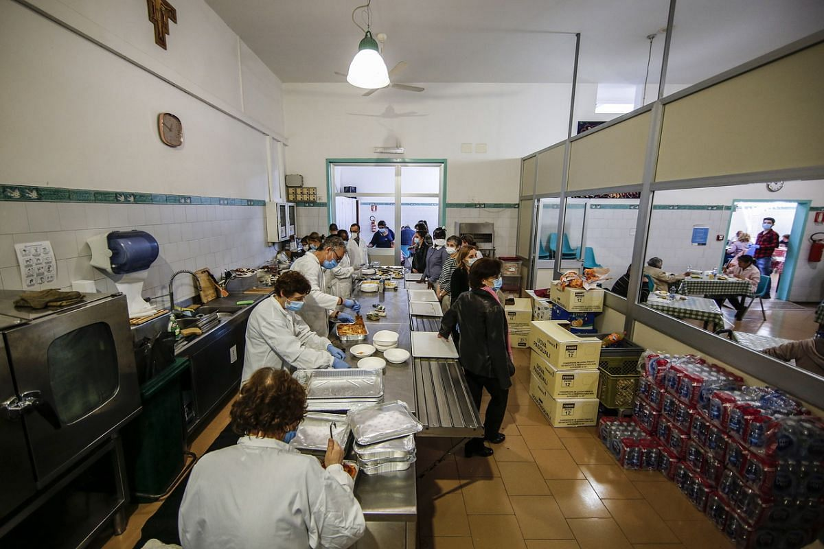 An Easter lunch for the homeless and poor is offered by the Catholic association known as the Community of Sant'Egidio in Rome on April 12, 2020.