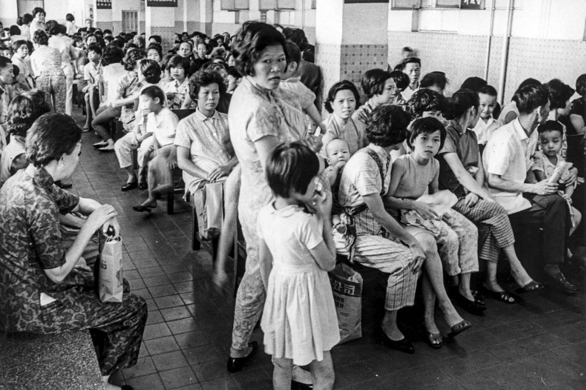 1968: HK FLU Above: Patients crowding the waiting hall of a clinic on Hong Kong Island during the flu pandemic in July 1968.