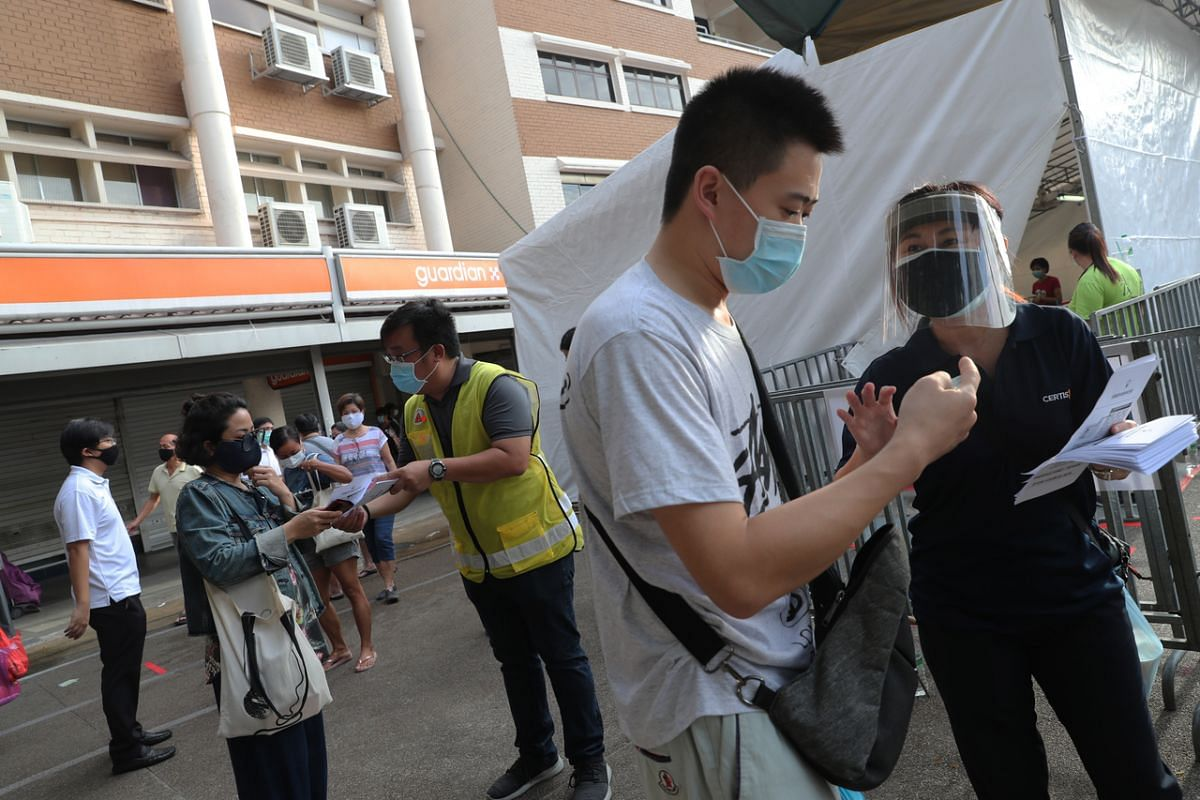Patrons have their identity cards checked before being allowed into the market at Block 505 Jurong West Street 52.