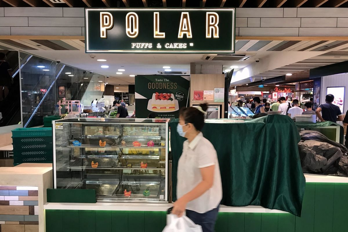 A shopper walks past a closed Polar Puffs and Cakes at White Sands mall in Pasir Ris on April 22, 2020.