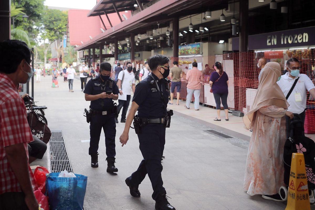 Police officers patrol outside Geylang Serai market ahead of Ramadan this week at 8.45am on April 22, 2020.