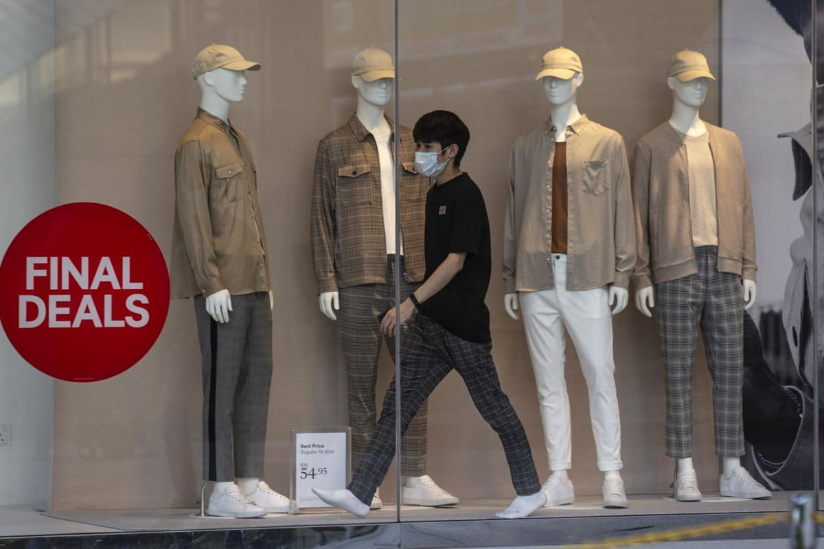 A worker checks a shop display in Kuala Lumpur on May 4, 2020.