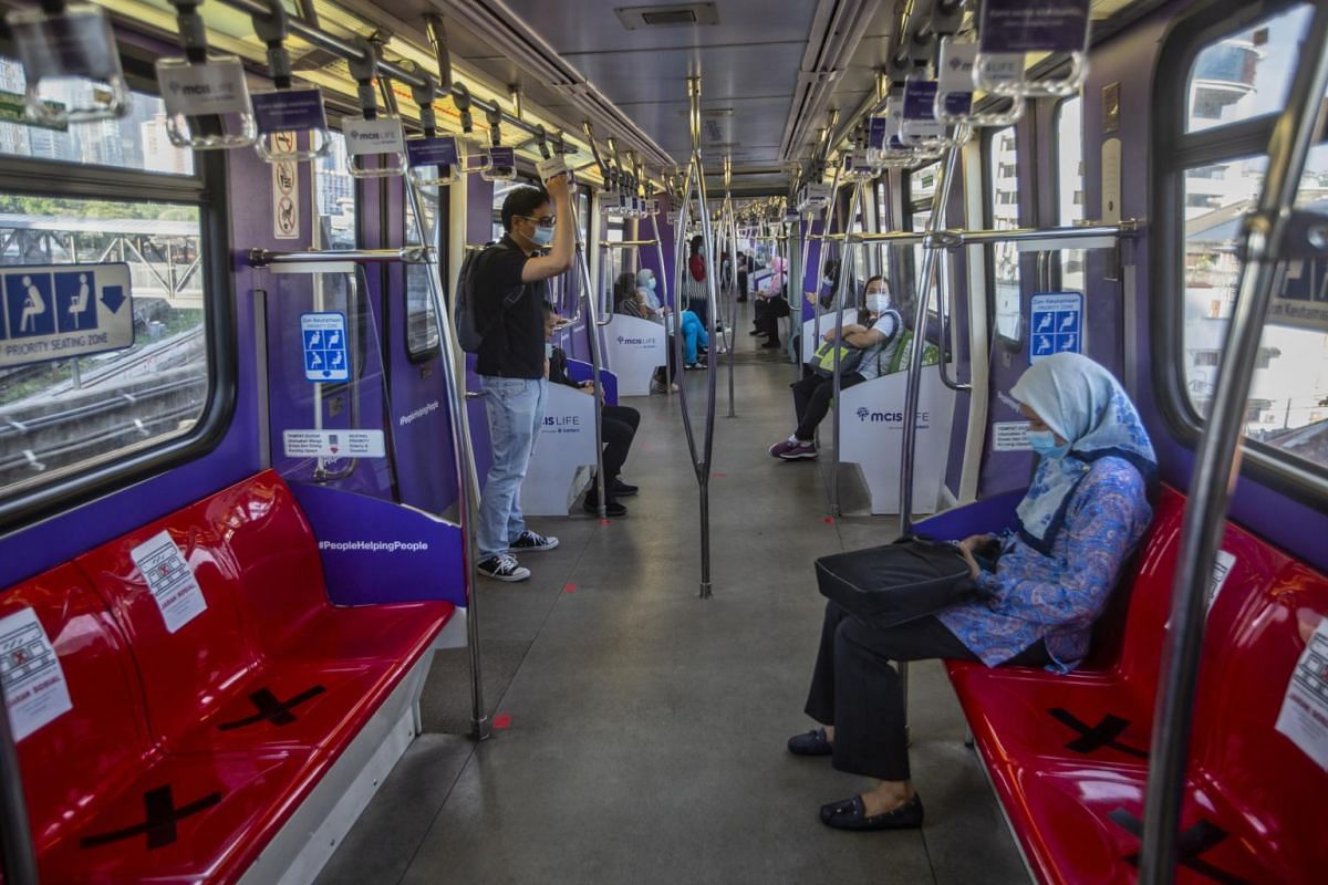 A seat is marked for social distancing on a train in Kuala Lumpur on May 4, 2020.