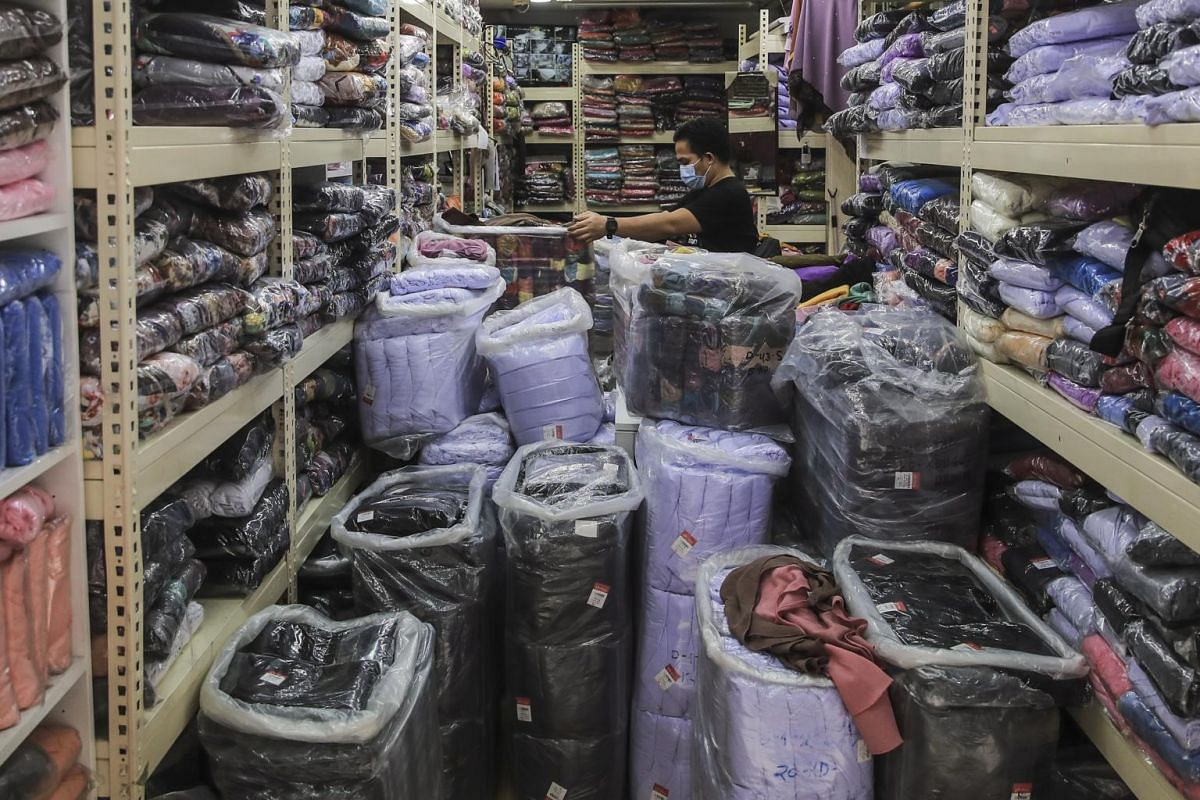 A workers prepares his shop for business after Malaysia eased coronavirus restrictions in Kuala Lumpur on May 4, 2020.