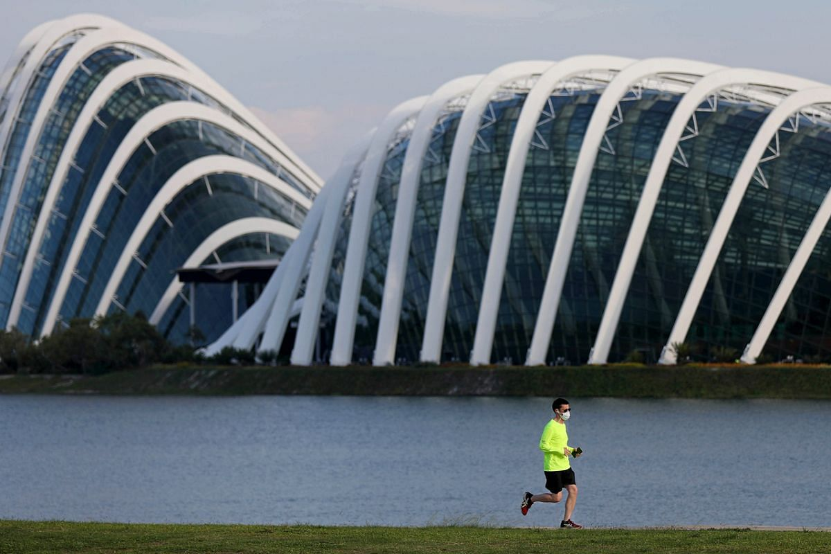 A jogger exercises with a mask on at Kallang Riverside Park on April 16, 2020.