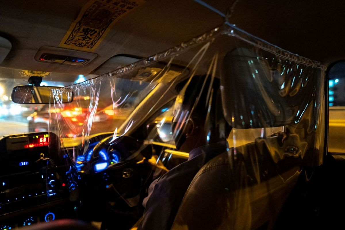 A taxi driver is pictured through a plastic barrier he installed in order to prevent the spread of the coronavirus disease (COVID-19) in Bangkok, Thailand, on May 12, 2020. REUTERS