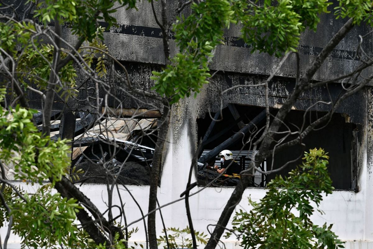 Aftermath of a fire at a Tuas warehouse in seen in a photo taken on May 13, 2020. PHOTO: THE STRAITS TIMES/LIM YAOHUI