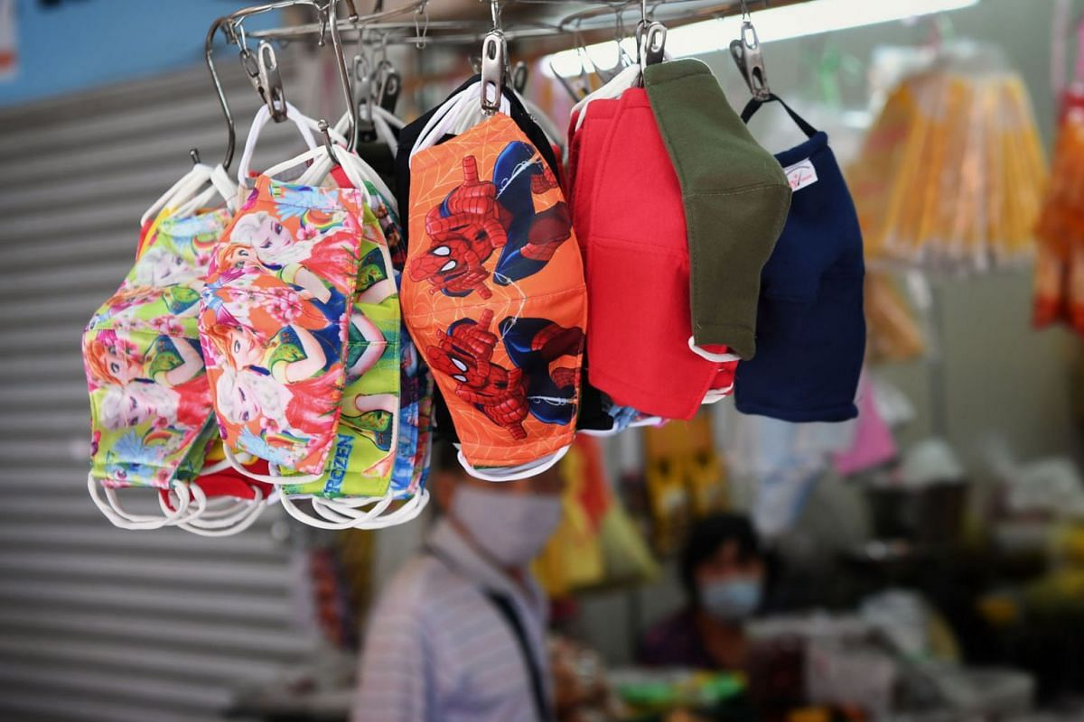 Colourful masks for sale are seen at a shop in Khatib Central in Yishun on May 13, 2020. PHOTO: THE STRAITS TIMES/KUA CHEE SIONG
