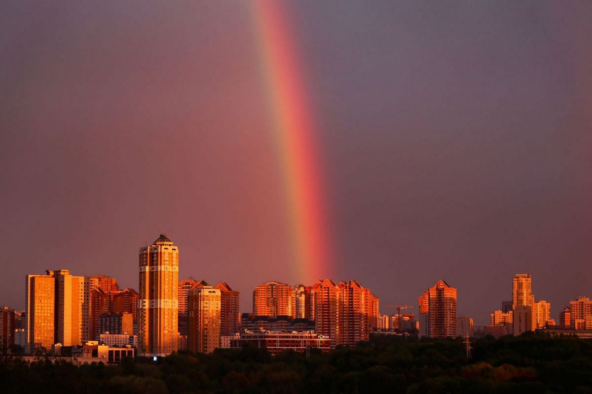 A rainbow appears with its spectrum shifted to red as it is formed by the setting sun after a rain shower over a residential area of Moscow, Russia, May 14, 2020. PHOTO: EPA-EFE