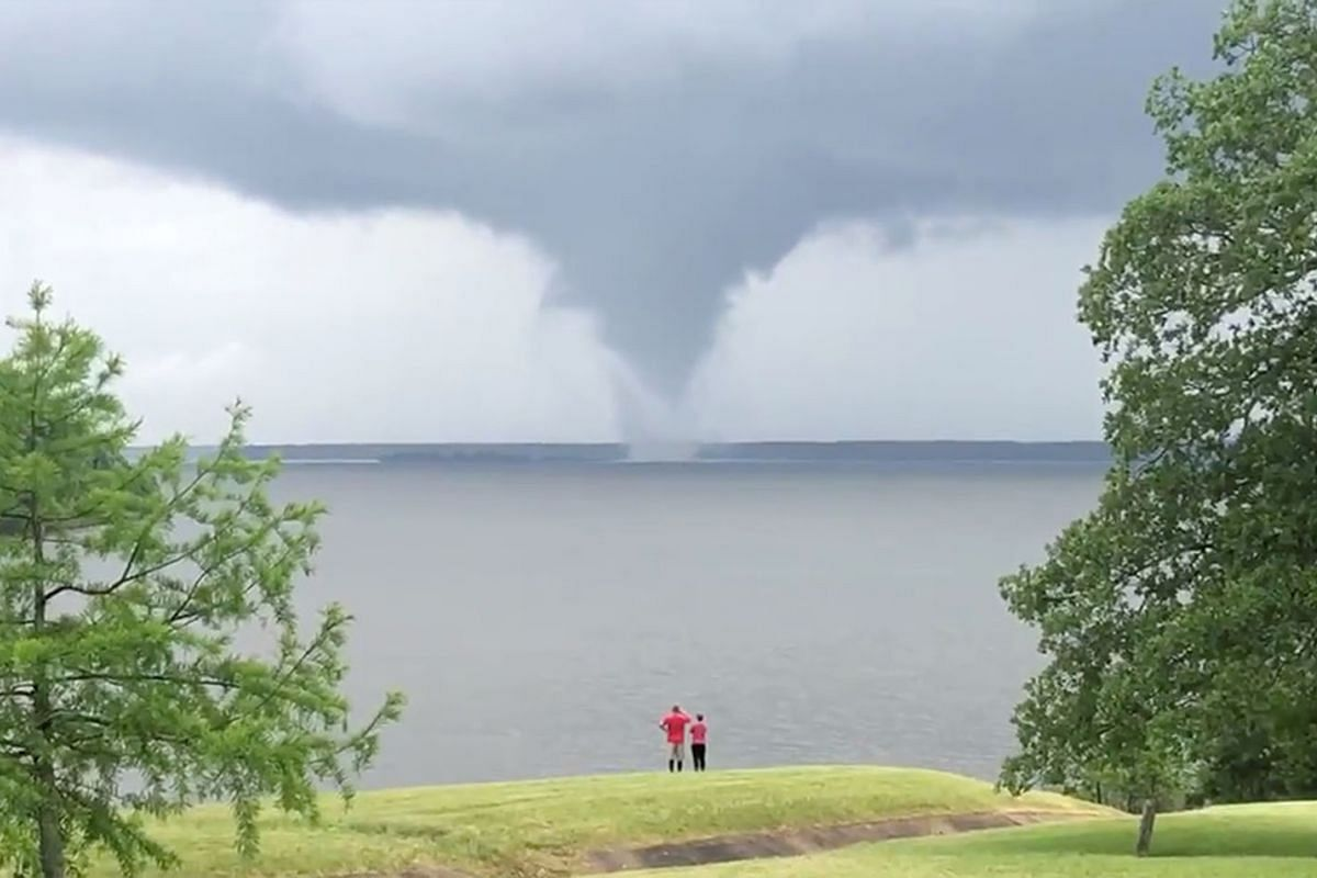 A waterspout is seen on Wright Patman Lake, Texas, U.S. May 16, 2020, in this still image obtained from a social media video. PHOTO: TEXAS GAME WARDEN VIS REUTERS