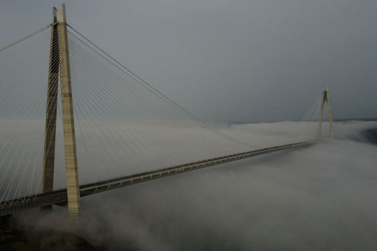 The Yavuz Sultan Selim Bridge over the Bosphorus is seen partly covered by fog during a 4 day curfew amid the spread of the coronavirus disease, in Istanbul, Turkey, May 17, 2020. PHOTO: REUTERS