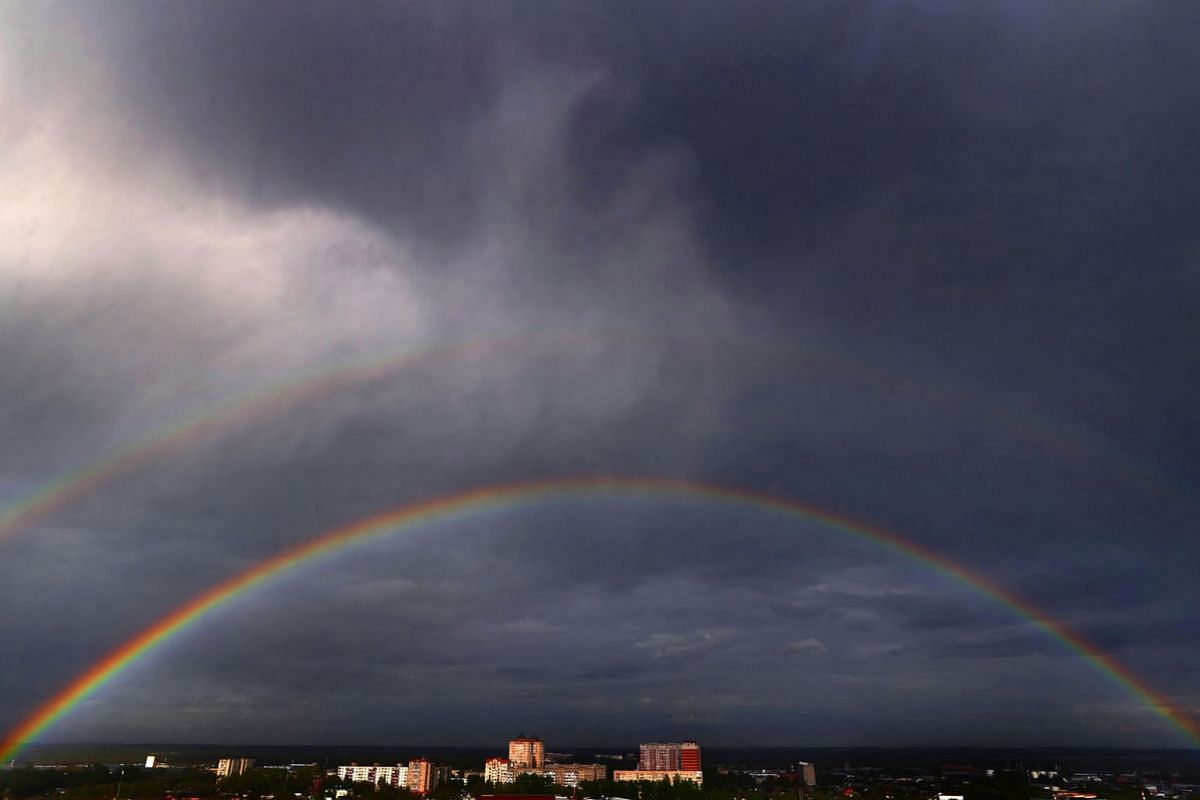 A view of a double rainbow over residential area in Moscow, Russia, 17 May 2020. EPA-EFE/MAXIM SHIPENKOV