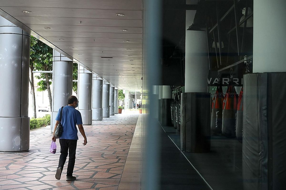 Above: An empty carpark at Marina Bay Cruise Centre on April 17, after Singapore barred cruise vessels from its ports on March 13. Below: Singapore adopted various safe distancing measures, such as staying at home and working from home, to reduce the