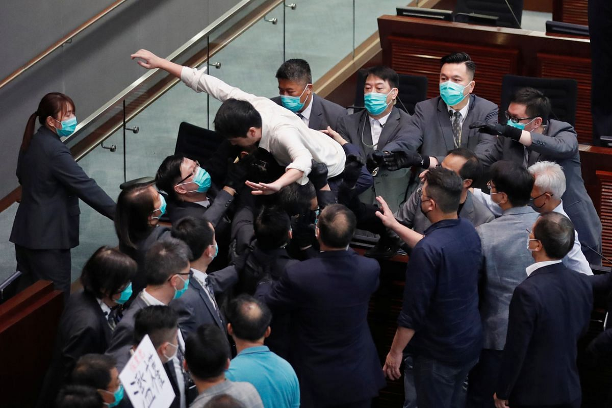 Pan-democratic legislator Hui Chi-fung scuffles with security during Legislative Council's House Committee meeting, on May 18, 2020.