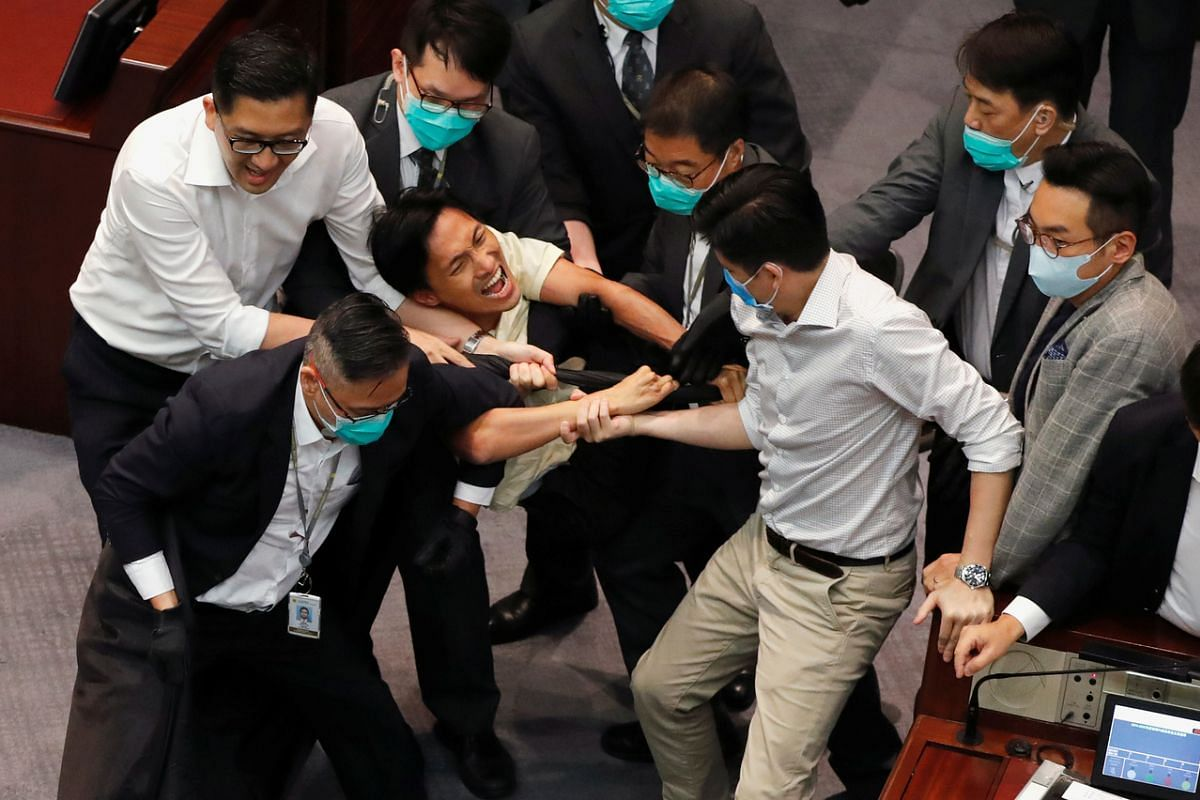 Pan-democratic legislator Chu Hoi-dick scuffles with security during Legislative Council's House Committee meeting, on May 18, 2020.