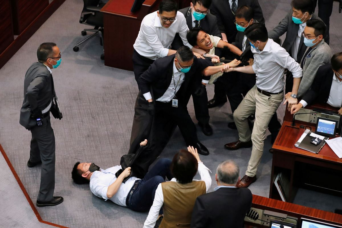 Pan-democratic legislators Chan Chi-chuen and Chu Hoi-dick scuffle with security during Legislative Council's House Committee meeting, on May 18, 2020.