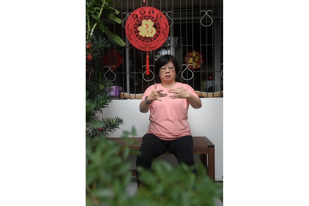 Madam Tan Sok Khoon, a retired financial controller, practising mindfulness, which involves sitting silently and paying attention to thoughts, sounds, the sensations of breathing or parts of the body, and bringing one's attention back whenever the mind st