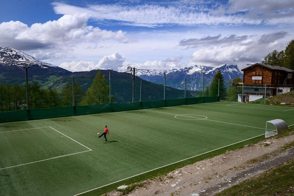 """The """"Ottmar Hitzfeld GsponArena"""" football pitch is seen in a photo taken on May 14, 2020 in the Alpine village of Gspon.  Despite the postponement of Euro 2020 because of the coronavirus pandemic, a small Swiss mountain village -- thought to be home"""