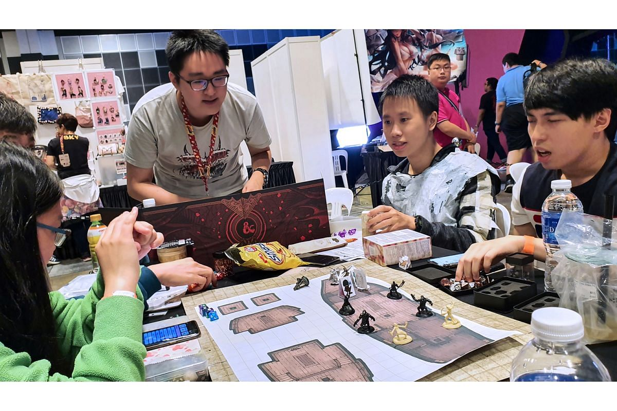 Dungeon Master Shane Yeow (above, centre) running the adventure, Assault On Myth Nantar, at Game Start 2019 held at Suntec City Convention Centre in October. More than 600 Singaporeans have been getting their board-gaming fix by playing online during