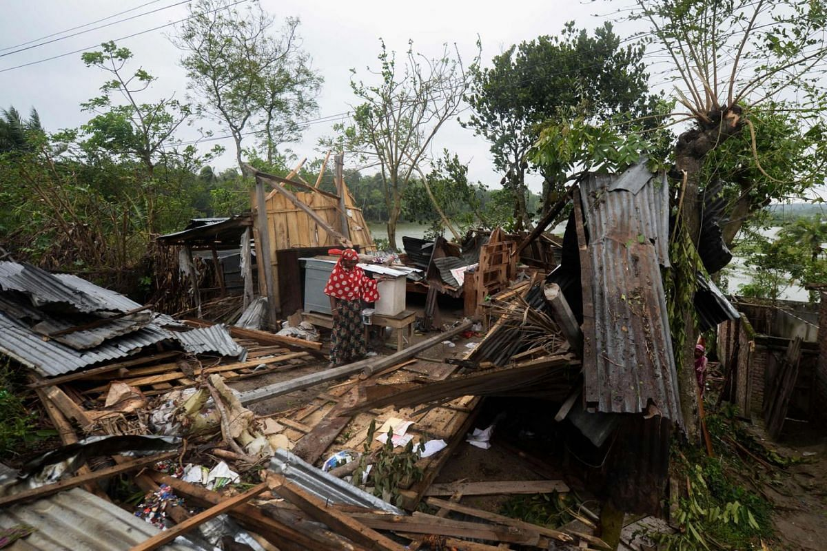 A woman stands amid the debris of her house damaged by cyclone Amphan in Satkhira, Bangladesh, on May 21, 2020. PHOTO: AFP