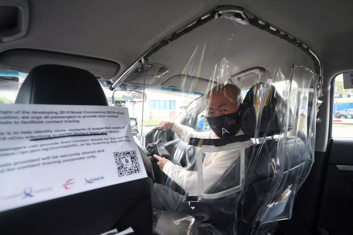 Taxi driver Koh Tian Moo, 66, in a cab that has been fitted with a plastic shield to minimise contact between drivers and passengers amid the Covid-19 outbreak in seen in a photo taken on May 20, 2020. ComfortDelGro Corp will fit 400 of its 10,000 ca