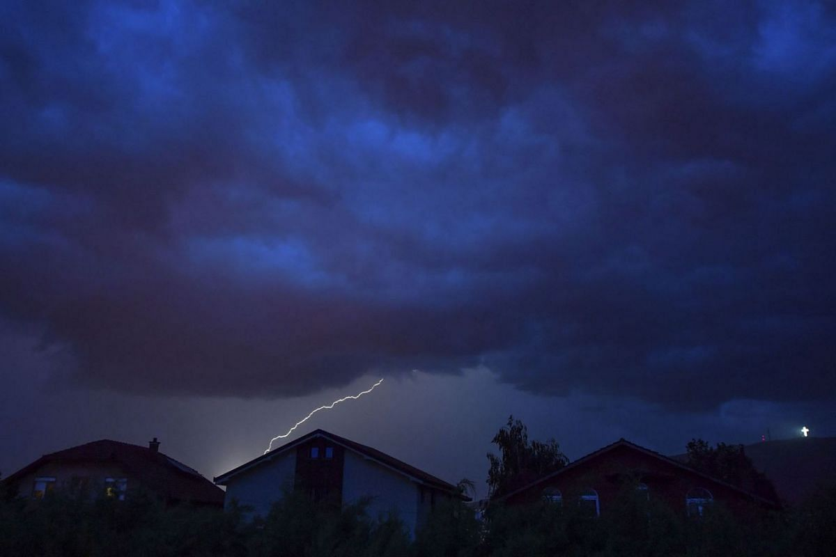 A lightning bolt strikes across the sky as a thunderstrom passes over the village of Bardovci near Skopje, Republic of North Macedonia on May 20, 2020. PHOTO: EPA-EFE