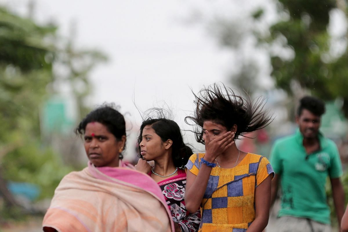 Villagers walk to a school building as they evacute, in Balikhali, India, on May 20, 2020.