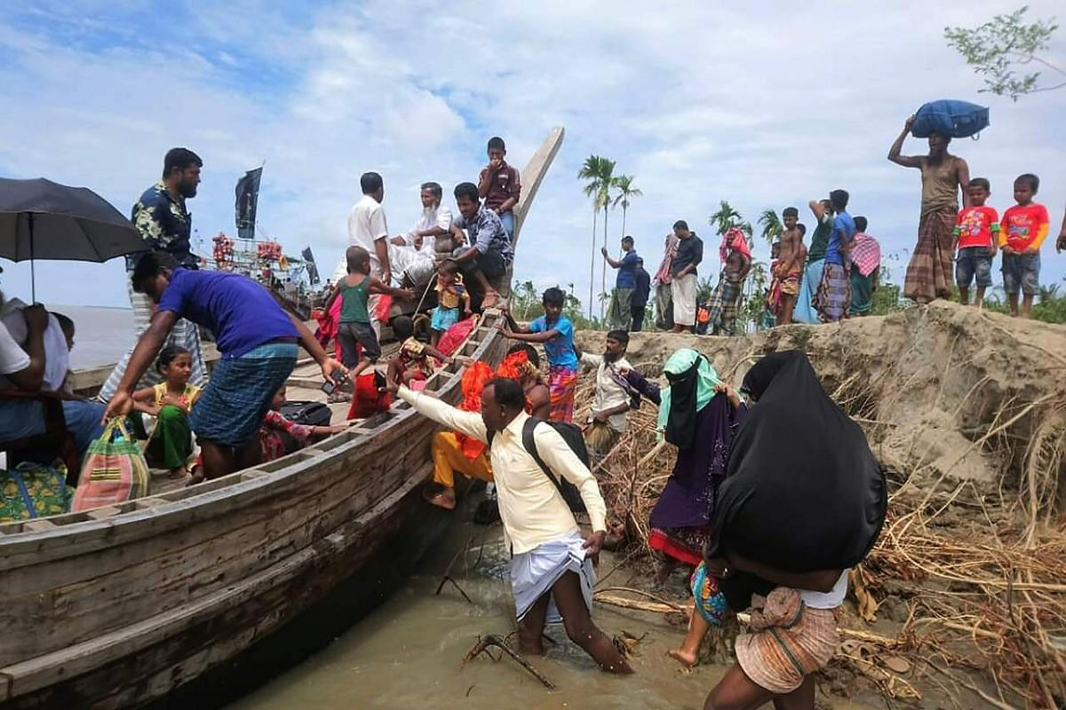 Residents being evacuated in Dhalchar village on the island of Bhola.