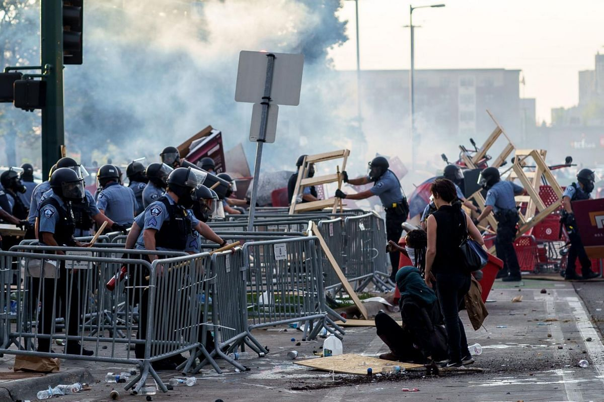 Police remove barricades set up by protesters, on May 27, 2020.