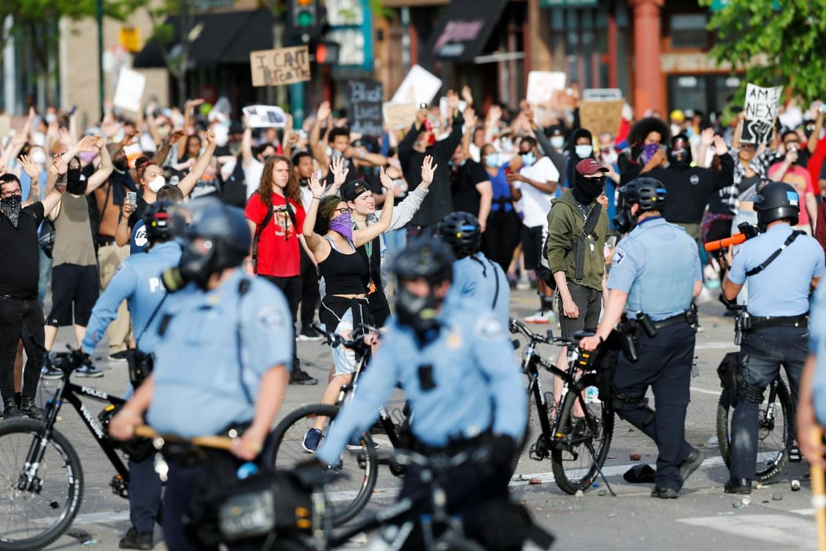People gather near the Minneapolis Police Third precinct on May 27, 2020.