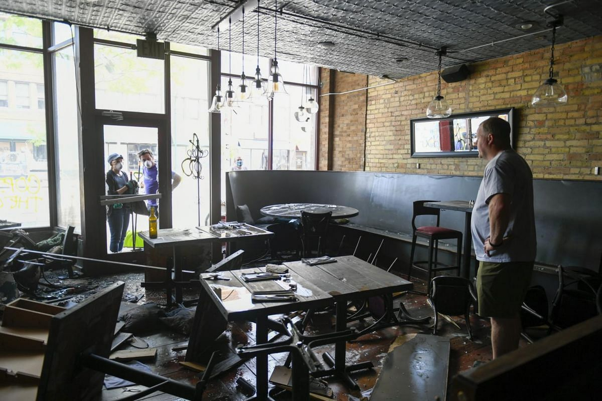 The owner of Talk Talk Diner Charles Stotts surveys the damage to his restaurant caused by looters, on May 28, 2020.