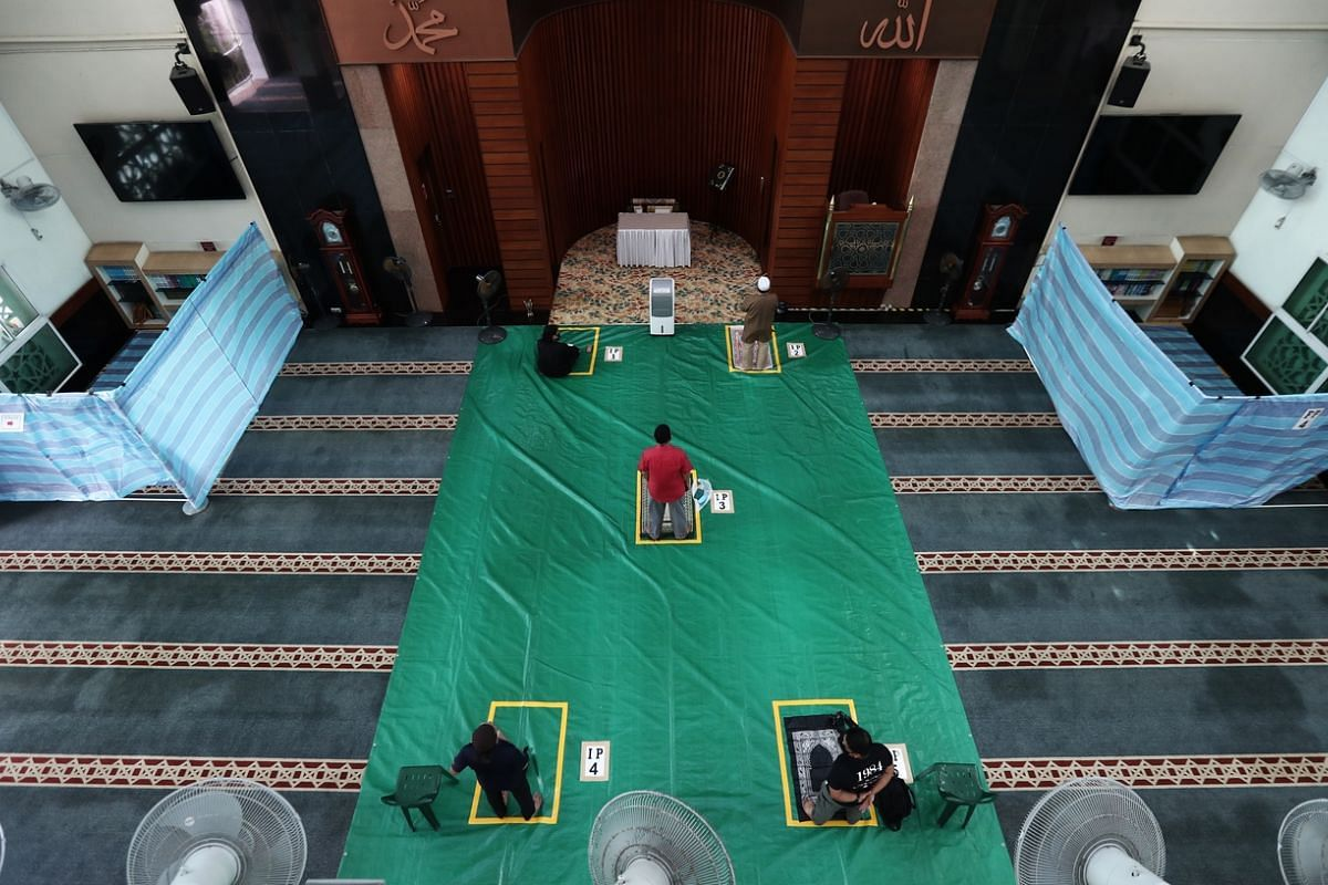 Safe distancing measures and contact tracing with temperature scanning being put at place Masjid Al-Iman in Bukit Panjang on June 2, 2020.