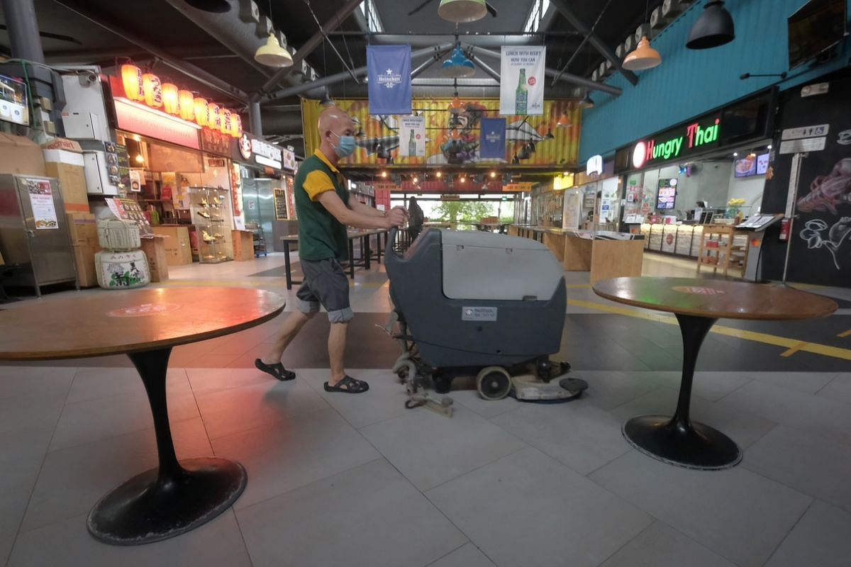A worker cleaning the floor at Timbre+ on June 18, 2020.