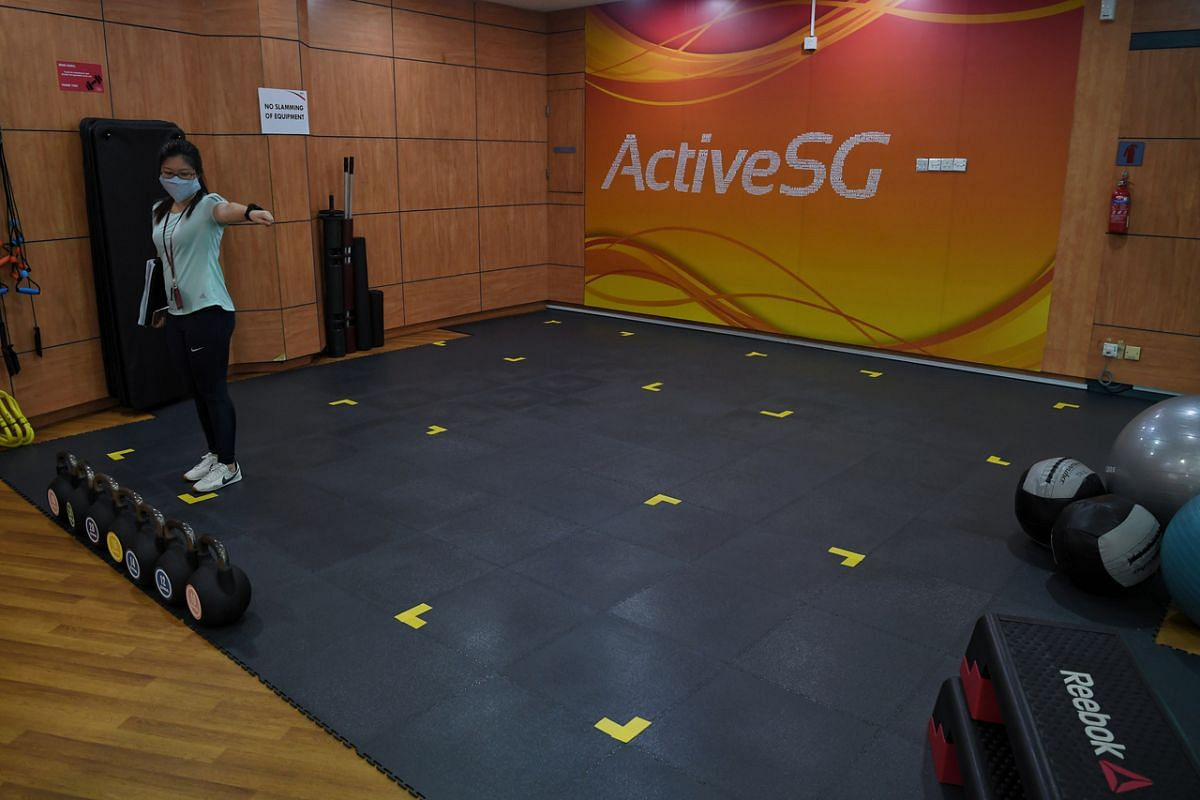 Safe distancing markers pasted on the mats in the gym at Jurong East Sport Centre.
