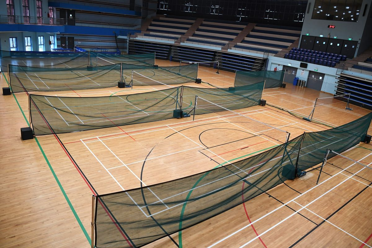Mash dividers placed between badminton courts at Jurong East Sport Centre.