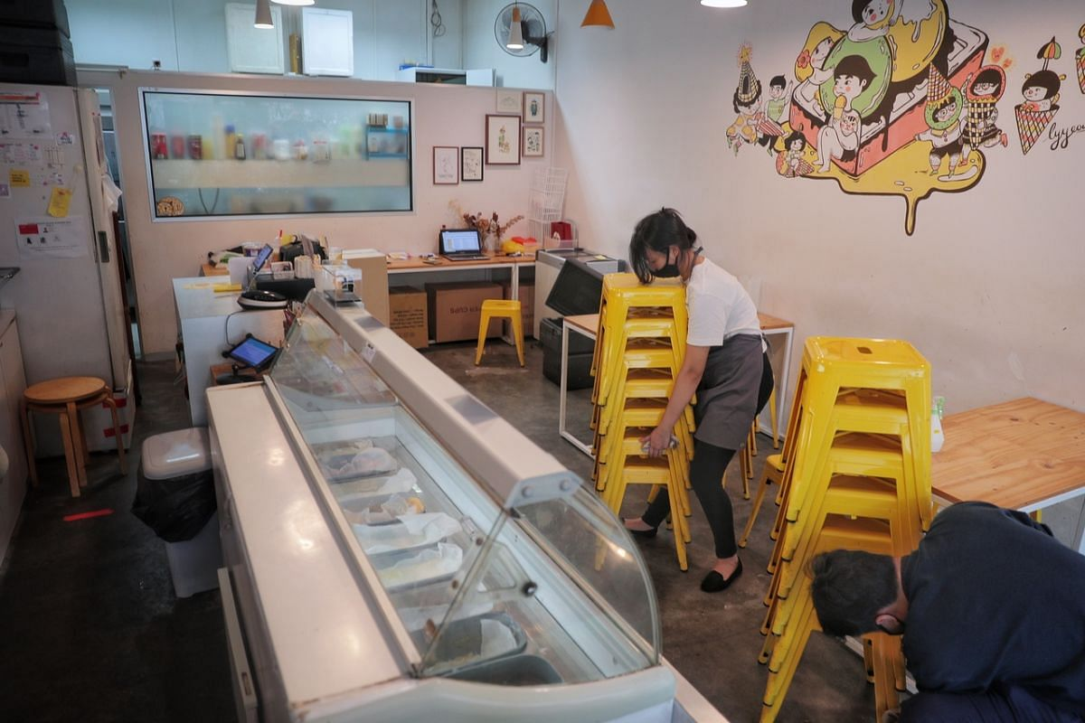 Staff cleaning chairs at Merely Ice Cream in Sunshine Plaza on June 18, 2020.