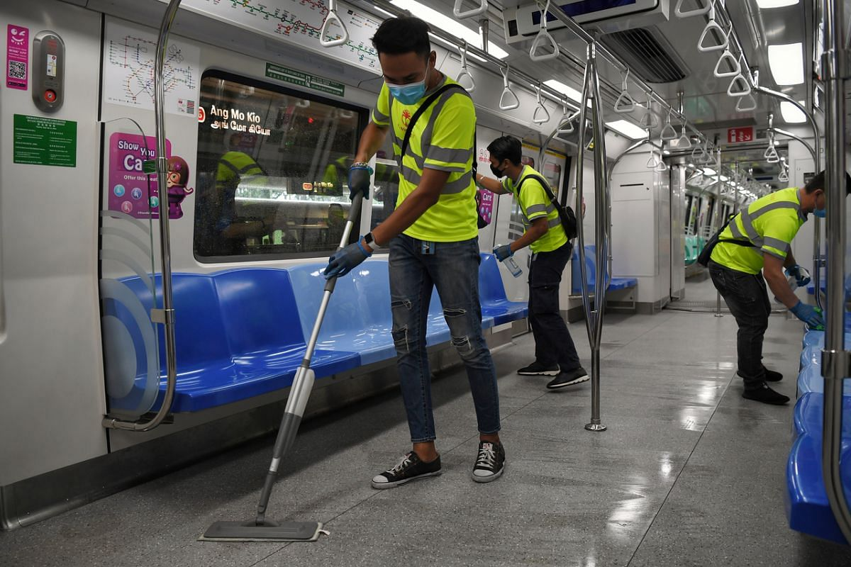 Workers cleaning an MRT train on June 17, 2020.